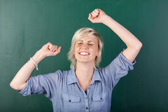 Blonde Woman Rejoicing By Chalkboard Stock Images