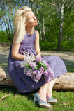 Blonde woman relaxing. In the spring forest Stock Photos