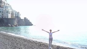 Blonde woman relaxing on the beach at the morning - Amalfi coast, Italy. stock video footage