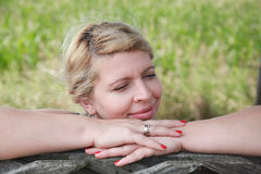 Blonde woman relaxing in nature Royalty Free Stock Photos