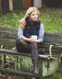Blonde woman relaxing outdoor Royalty Free Stock Images