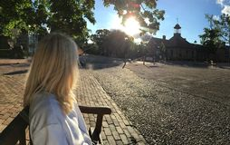 Woman on bench in Williamsburg Virginia Royalty Free Stock Images