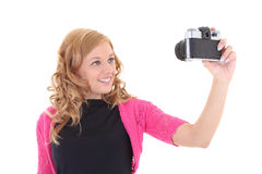 Blonde woman with retro camera Royalty Free Stock Photos