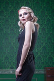 Blonde woman retro style in green vintage room Royalty Free Stock Photos