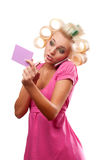 Blonde woman with rollers Stock Photography