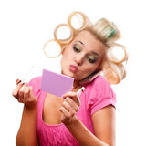 Blonde woman with rollers Stock Images