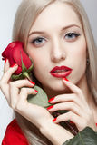 Blonde woman with rose Royalty Free Stock Image