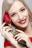 Blonde woman with rose Stock Images