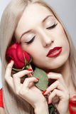 Blonde woman with rose Stock Image