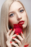 Blonde woman with rose Stock Photos