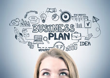 Blonde woman s head and a business plan Royalty Free Stock Photography