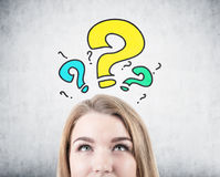 Blonde woman s head, question marks Royalty Free Stock Photo