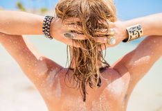 Blonde woman with sandy hair by the beach Stock Photos