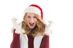 Blonde woman in santa hat screaming at camera Stock Photos