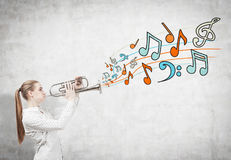 Blonde woman with a saxophone, notes Royalty Free Stock Photography