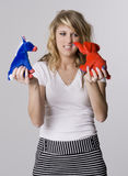 A blonde woman scolds the Republicans. A blonde girl wonders about voting for Republicans or Democrats Stock Image