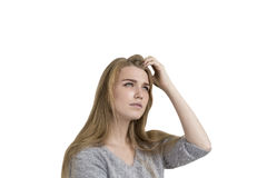Blonde woman scratching head, isolated Royalty Free Stock Photos