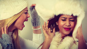 Blonde woman screaming on her friend. Royalty Free Stock Photos
