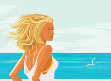 Blonde woman at the sea Stock Photos