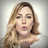 Blonde woman sending air kiss. Royalty Free Stock Photo