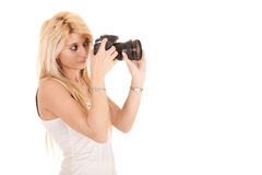 Blonde woman shooting picture Stock Photo