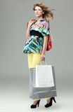 Blonde woman shopping bags Stock Images