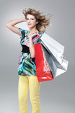 Blonde woman shopping bags Royalty Free Stock Image
