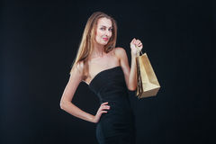 Blonde woman with shopping bags Royalty Free Stock Photo