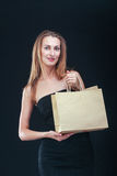 Blonde woman with shopping bags Stock Photos