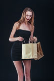 Blonde woman with shopping bags Royalty Free Stock Image