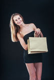Blonde woman with shopping bags Stock Photography