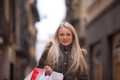 Blonde woman shopping touring in Europe Royalty Free Stock Photo