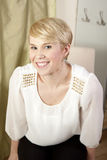 Blonde woman with short hair smiling Stock Photos