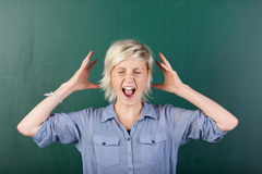 Blonde Woman Shouting By Chalkboard Royalty Free Stock Image