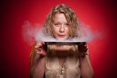 Blonde woman show  magic Stock Image