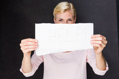 Blonde woman showing help sign Stock Images