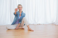 Blonde woman showing new house keys Stock Photography