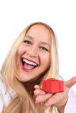 Blonde woman shows present Stock Image