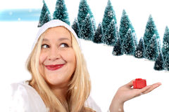 Blonde woman shows present Stock Photo
