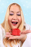 Blonde woman shows present Royalty Free Stock Photos