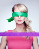 Blonde woman with silk ribbons. Royalty Free Stock Image
