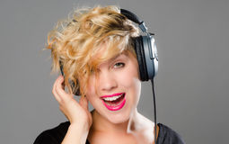 Blonde woman singing along Stock Images