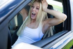 Blonde Woman Sitting In Car And Screaming Stock Photos