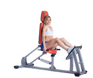 Blonde woman sitting  on isodynamic exerciser Stock Images