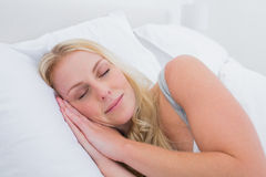 Blonde woman sleeping in her bed Royalty Free Stock Photography