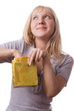 Blonde woman with small gift bag. Blonde woman standing with small gift bag royalty free stock image