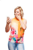 Blonde woman with smartphone Royalty Free Stock Photography