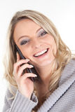 Blonde woman with smartphone Royalty Free Stock Image