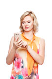 Blonde woman with smartphone Stock Photography