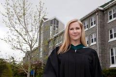 Happy intelligent graduate student stock images